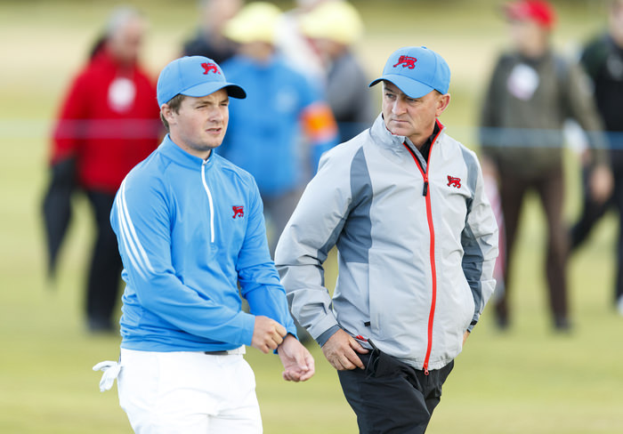 Captain Nigel Edwards, right, and Jack Hume, left, walk down the 18th hole during an afternoon singles match at the 2015 Walker Cup at Royal Lytham & St. Annes G.C. in Lytham St Annes, Lancashire on Saturday, Sept. 12, 2015. (Copyright USGA/Chris Keane)