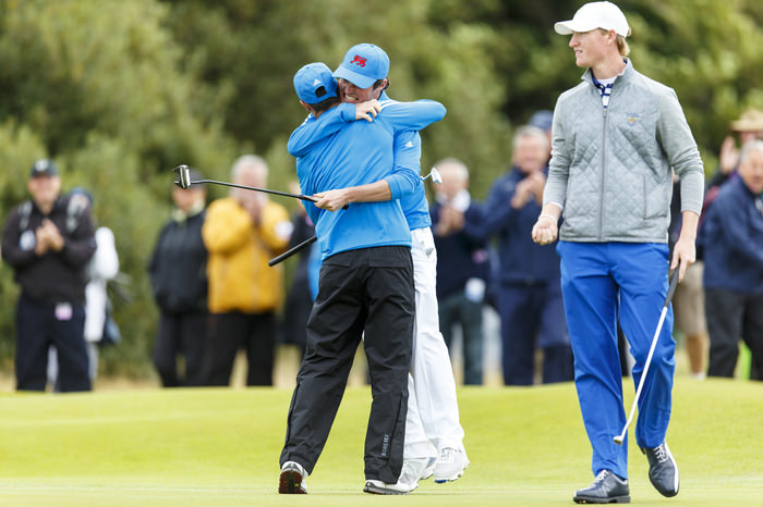 Cormac Sharvin, right, shares a hug with Jack McDonald, left, after they won their match on the 14th hole during the morning foursomes matches of the 2015 Walker Cup at Royal Lytham & St. Annes G.C. in Lytham St Annes, Lancashire on Saturday, Sept. 12, 2015. (Copyright USGA/Chris Keane)