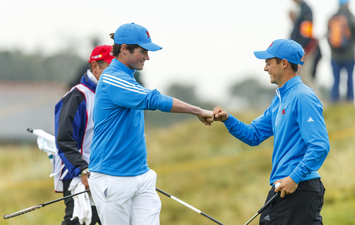 Cormac Sharvin, left, and Jack McDonald, right, fist bump after winning the third hole during the morning foursomes matches of the 2015 Walker Cup at Royal Lytham & St. Annes G.C. in Lytham St Annes, Lancashire on Saturday, Sept. 12, 2015. (Copyright USGA/Chris Keane