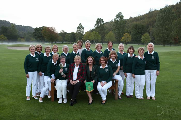 Woodenbridge Golf Club - Mary McKenna Diamond Trophy Team 2015  Back Row (LtoR)  Maura Crummy, Mary McGrath, Madeline O'Dwyer, Breda Murphy, Breda Flanigan, Siobhan Saunders, Susan Fitzpatrick, Elizabeth Byrne, Mary McDonald, Sandra Watkins, Josephine Birthistle, Bernie Doyle, Marie Hegarty, Dorothy Russell.    Front Row (LtoR) Ger Murphy, Beatrice Duffy (Manager) Mary McKenna MBE, Lady Captain Paula Tanham, Aileen Sheehan and Bernie Doran (Lady Vice Captain)
