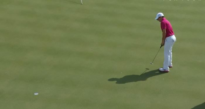 Rory McIlroy holes a putt at Conway Farms
