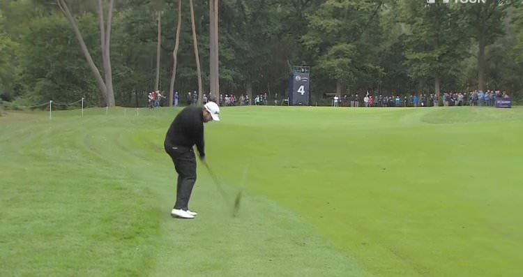 Shane Lowry stripes another iron shot into one of Woburn's soft greens.