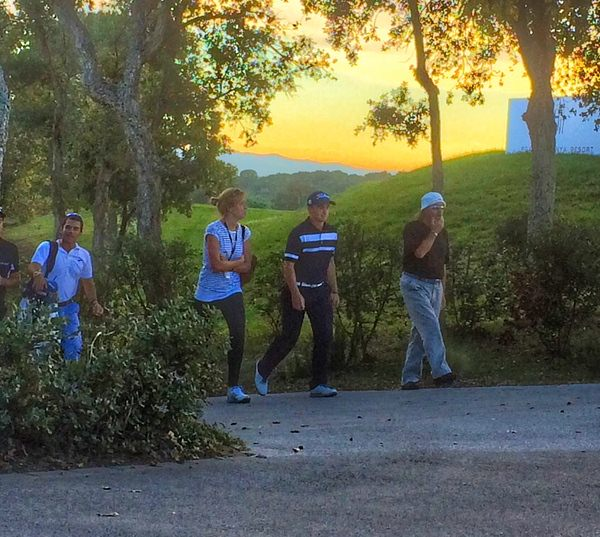 Paul Dunne, accompanied by a representative from his management company (centre left), walks off the 18th at PGA Catalunya Resort's Stadium Course towards the recorders hut following his three under 69 in the fifth round of Q-School, 18 November 2015.