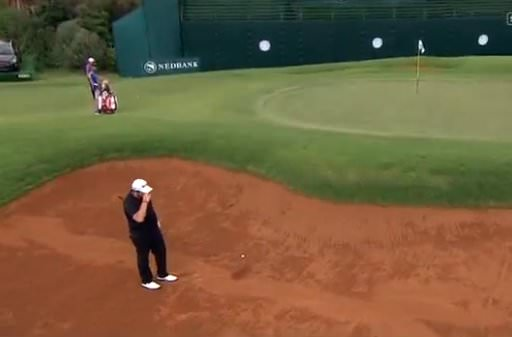Shane Lowry laments his first bunker shot at the 18th