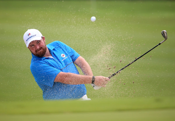 Shane Lowry of Ireland plays out of a bunker on the 16th in the 2016 EurAsia Cup presented by DRB-HICOM at Glenmarie Golf and Country Club. Picture: Mark Dadswell/Asian Tour