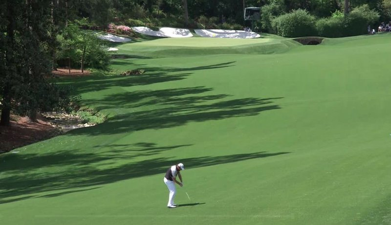 Shane Lowry hits his second to the 13th
