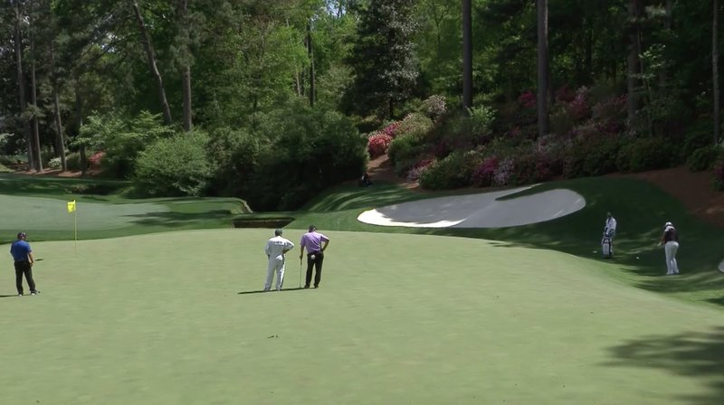 Shane Lowry chips dead at the 13th to set up a birdie four