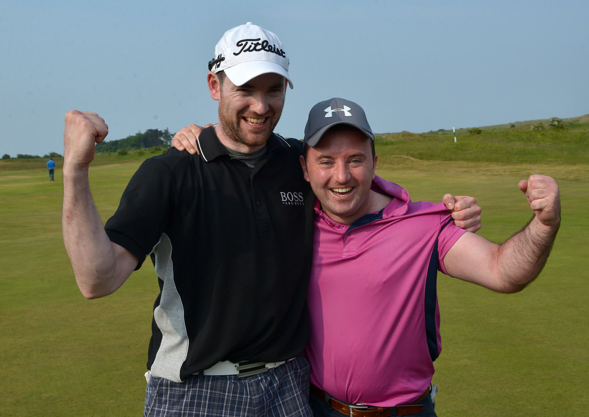 Paul O'Hanlon (Carton House) celebrates with his caddy Richie Whelan on the 18th green after his victory in the CityNorth Hotel sponsored East of Ireland Championship. Picture by  Pat Cashman