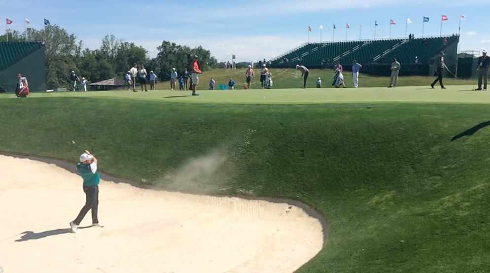 Shane Lowry plays out of a bunker on the 17th at Oakmont