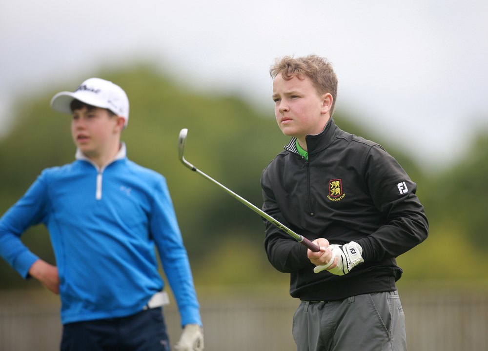 Eventual winner Ciaran Mahon ( Kilcock) intently watches his tee shot at the 17th at Elm Hall as Eoin Freeman (Naas) looks on. Picture: Ronan Lang