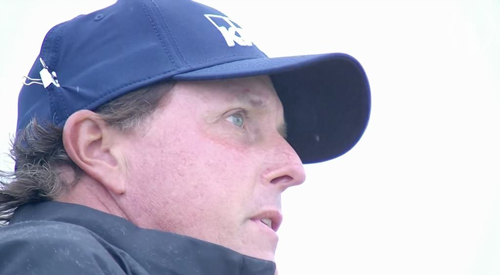 Phil Mickelson with his anti-wind clip on his cap