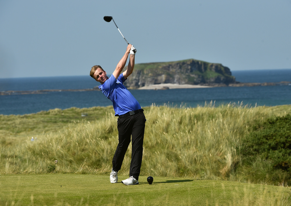 Thomas Mulligan (Co Louth) driving at the 6th tee with Glashedy Island in the background during the first strokeplay round of the 2016 Irish Amateur Close Championship at Ballyliffin Golf Club today (16/08/2016). Picture by  Pat Cashman