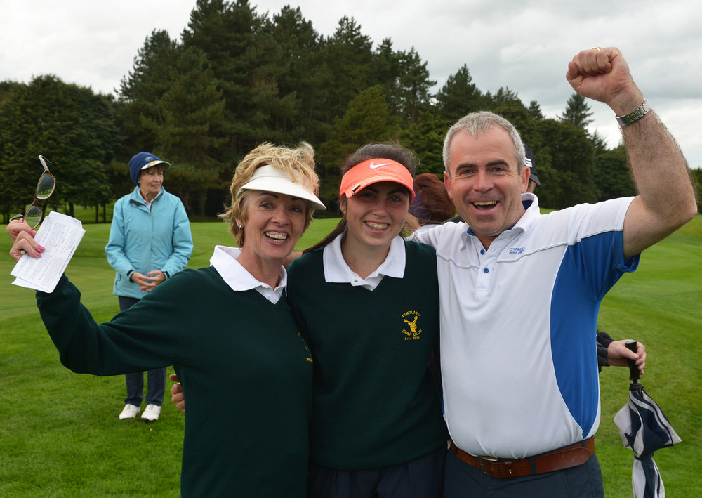 Portumna's Sinead Lohan (centre) celebrates with her caddie Mary Conwell and her father Padraig after winning her match and the AIG Intermediate Cup on the 18th green in the AIG Ladies Cups & Shields at Dundalk.Picture by  Pat Cashman