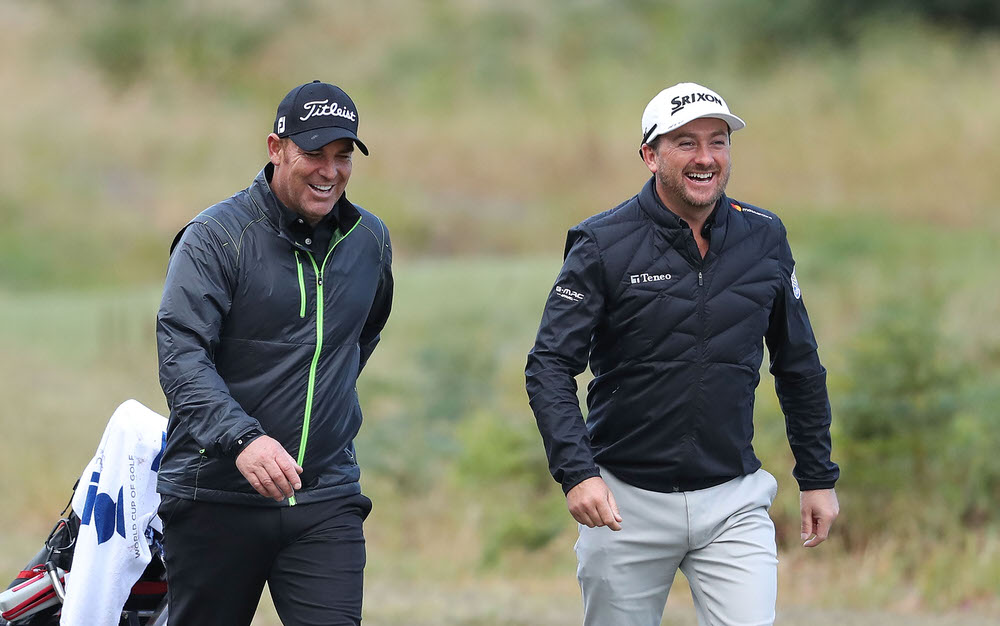 MELBOURNE, AUSTRALIA - NOVEMBER 23: Former cricketer Shane Warne (L) looks on as he plays with Graeme McDowell of Northern Ireland on Pro-Am Day ahead of the World Cup of Golf at Kingston Heath Golf Club on November 23, 2016 in Melbourne, Australia. (Photo by Scott Barbour/Getty Images)