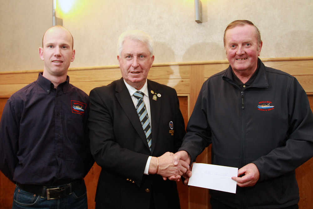 Munster Golf Chairman John Moloughney presents a cheque to Emmet Murphy and Willie Walsh from Mallow Search & Rescue, Munster Golf's nominated charity for 2016. Picture: Niall O'She