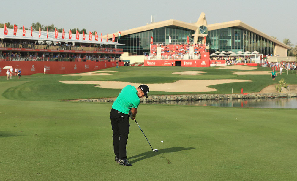 ABU DHABI, UNITED ARAB EMIRATES - JANUARY 21: Tyrrell Hatton of England plays his second shot on the 18th hole during the third round of the Abu Dhabi HSBC Championship at the Abu Dhabi Golf Club on January 21, 2017 in Abu Dhabi, United Arab Emirates. Photo:David Cannon/Getty Images