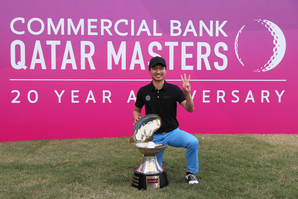 DOHA, QATAR - JANUARY 29:  Jeunghun Wang of South Korea poses with the trophy following his victory in the playoff during the fourth round of the Commercial Bank Qatar Masters at the Doha Golf Club on January 29, 2017 in Doha, Qatar.  (Photo by Andrew Redington/Getty Images)