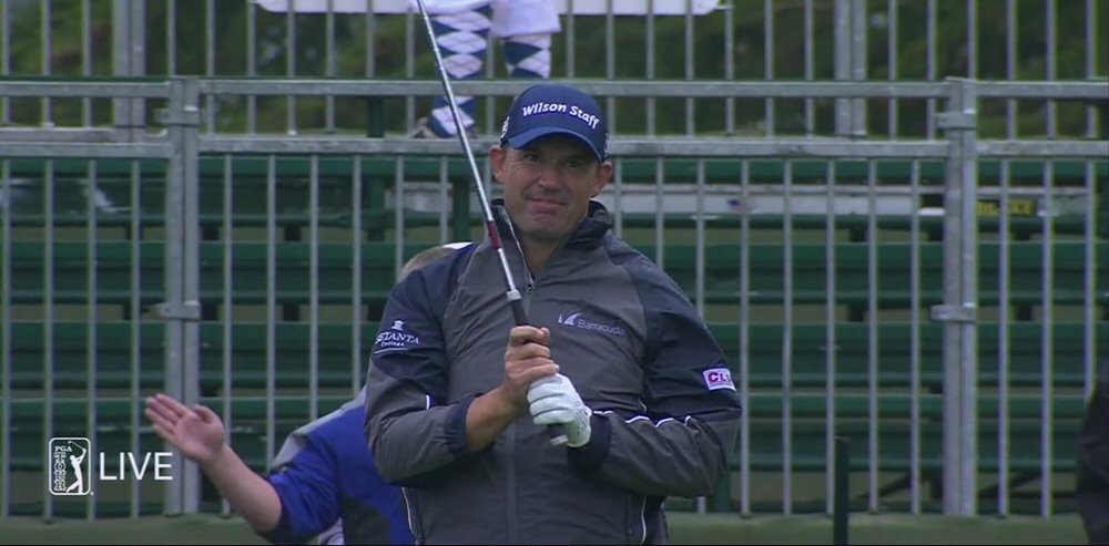 Pádraig Harrington watches as his tee shot comes up 15 yards short of the green at the 17th