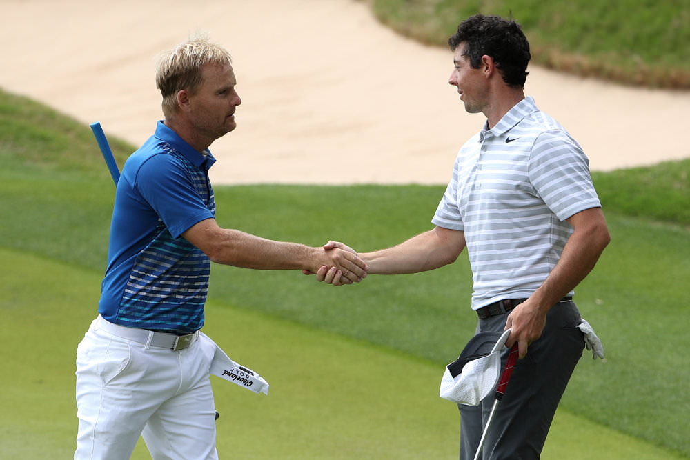 AUSTIN, TX - MARCH 22: Soren Kjeldsen (L) of Denmark shakes hands with Rory McIlroy of Northern Ireland after winning their match during round one of the World Golf Championships-Dell Technologies Match Play at the Austin Country Club on March 22, 2017 in Austin, Texas. (Photo by Christian Petersen/Getty Images)
