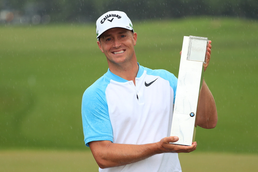 VIRGINIA WATER, ENGLAND - MAY 28: Alex Noren of Sweden celebrates victory with the trophy after the final round on day four of the BMW PGA Championship at Wentworth on May 28, 2017 in Virginia Water, England. (Photo by Andrew Redington/Getty Images)