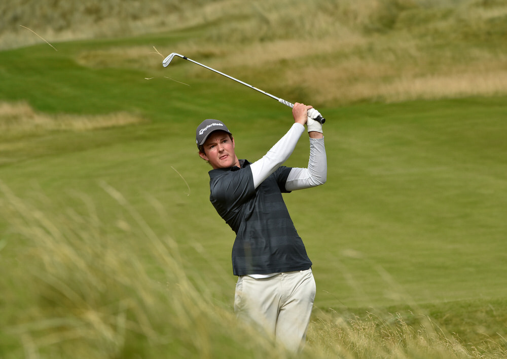 John Ross Galbraith (Whitehead) playing his second shot to the 9th green during his quarter-final match at the AIG Irish Amateur Close Championship at Ballyliffin Golf Club 19 August 2016. Picture by  Pat Cashman