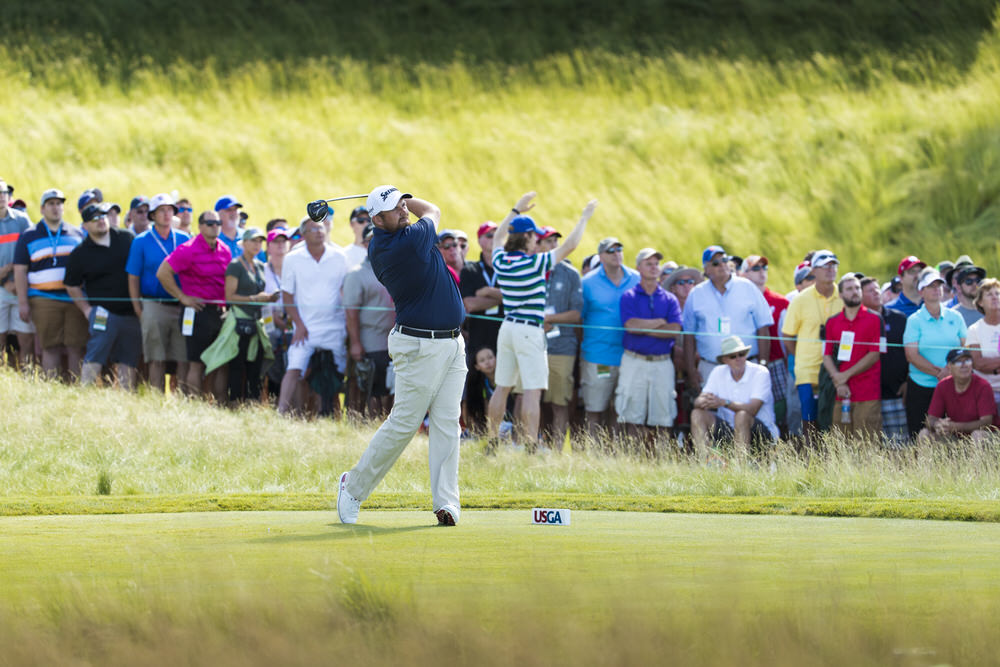 Shane Lowry watches his tee shot on the first hole during the third round of the 2017 U.S. Open at Erin Hills in Erin, Wis. on Saturday, June 17, 2017. (Copyright USGA/Chris Keane)