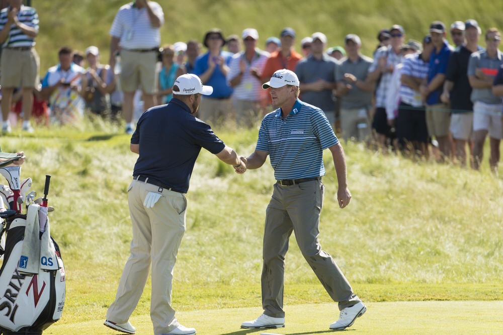 Steve Stricker, right, shakes hands with Shane Lowry, left, on the first hole during the third round of the 2017 U.S. Open at Erin Hills in Erin, Wis. on Saturday, June 17, 2017. (Copyright USGA/Chris Keane)