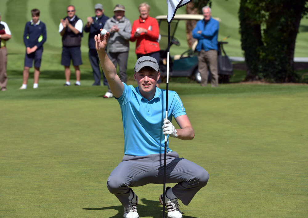 Mark Power picks his ball out of the cup after his dramatic 129-yard hole out of an eagle two to win the Irish Boys Amateur Open at the final hole of a three-hole aggregate playoff at Castletroy. Picture:  Pat Cashman