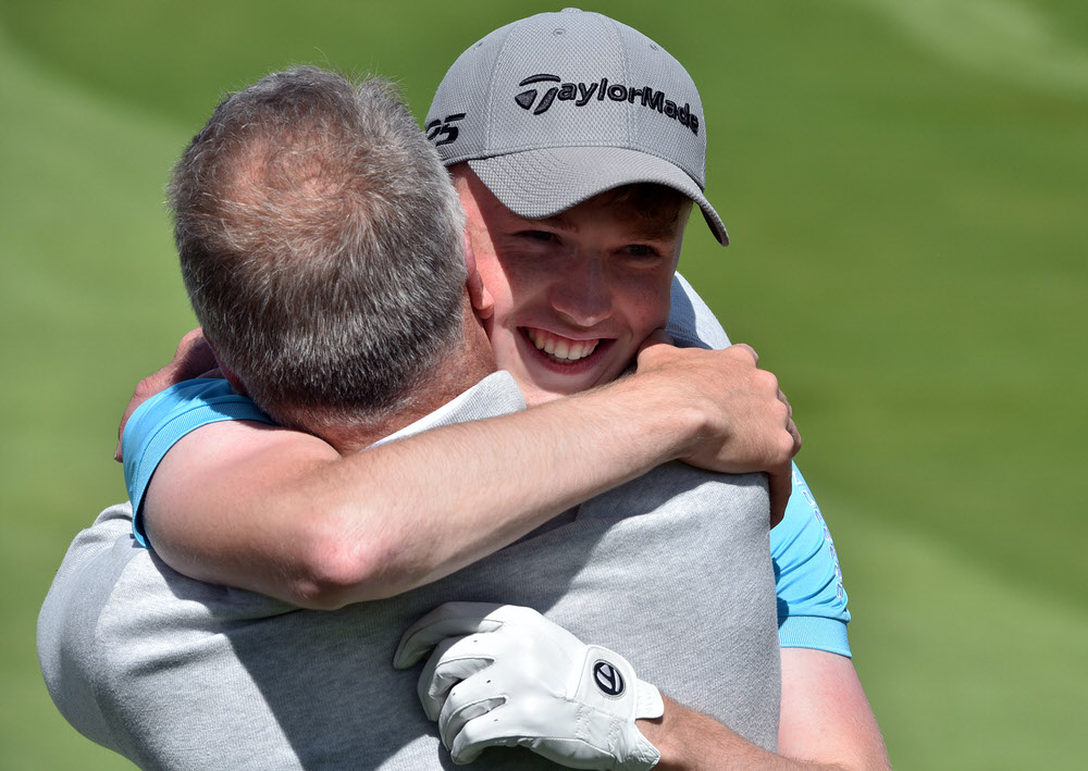 Mark Power (Kilkenny) is congratulated by his father Eddie after holing his second shot at the 3rd tie hole to win the 2017 Irish Boys Amateur Open Championship at Castletroy Golf Club. (26/06/2015).Picture:  Pat Cashman