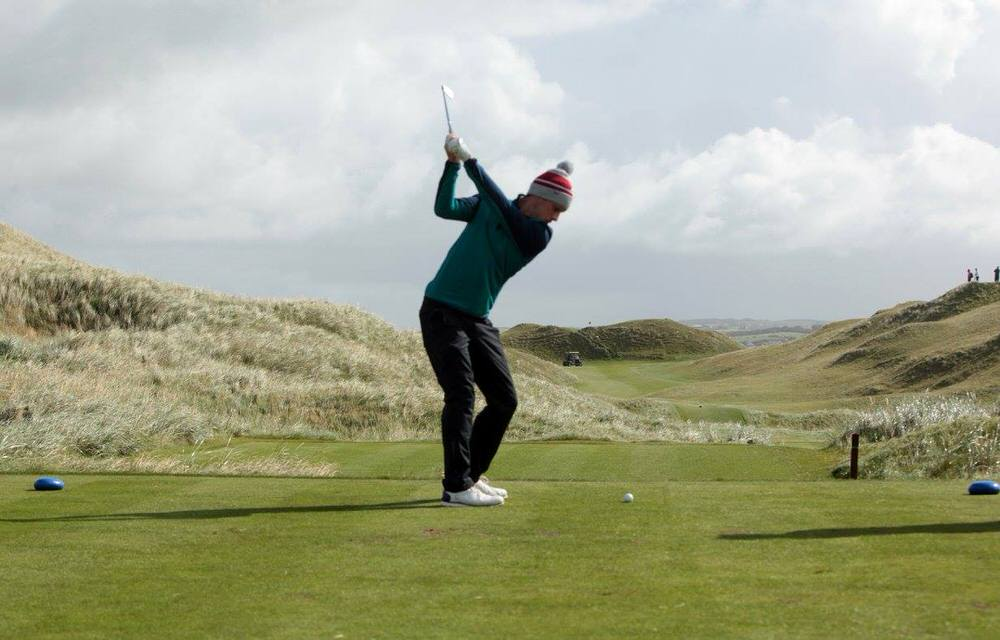 Irish Amateur Close champion Alex Gleeson (Castle) hits an iron down the fourth in the second qualifying round in the South of Ireland Amateur Open at Lahinch. Picture © Gordon Adair