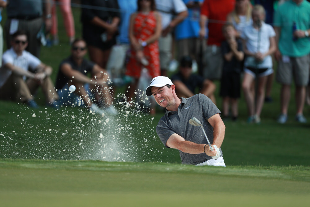 CHARLOTTE, NC - AUGUST 11: Rory McIlroy of Northern Ireland hits out of the bunker on the first hole during Round Two for the 99th PGA Championship held at Quail Hollow Club on August 11, 2017 in Charlotte, North Carolina. (Scott Halleran/PGA of America)