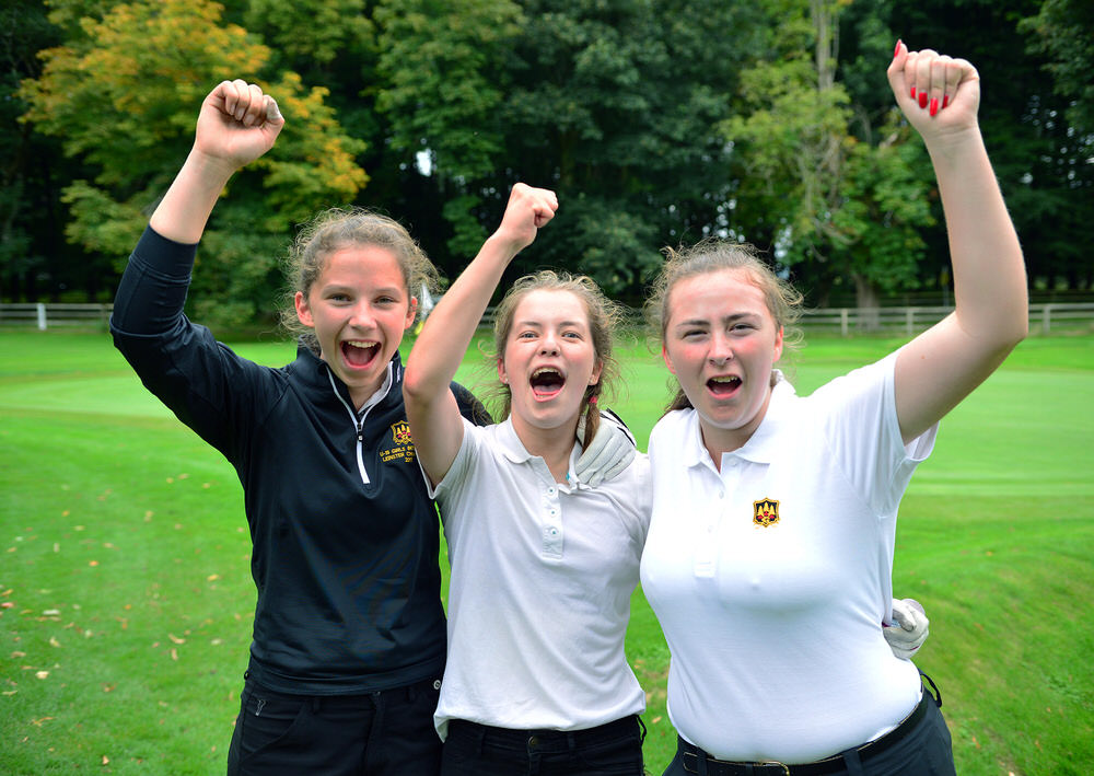 Grange team members (from left) Rachel Lynch, Ciara Corcoran and Ellen Nolan celebrate their victory on the 17th green in the 2017 Girl's Inter Club Challange Trophy at Royal Curragh Golf Club Golf today (27/08/2017). Picture by  Pat Cashman