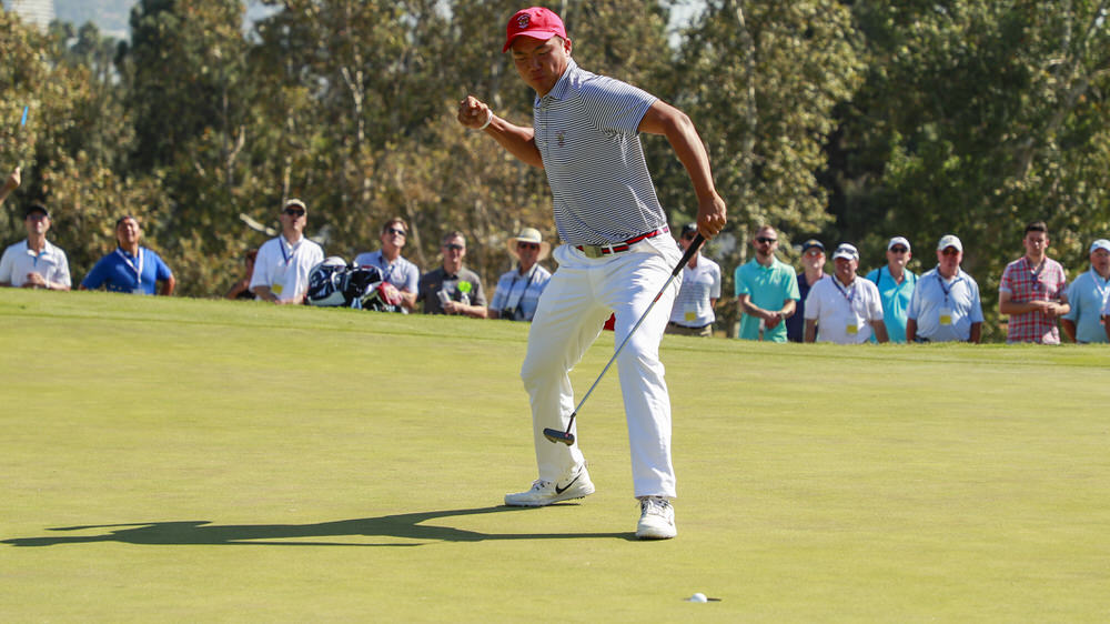 Norman Xiong (USA) reacts to his made birdie putt on the 16th hole during singles at the 2017 Walker Cup at The Los Angeles Country Club in Los Angeles, Calif. on Sunday, Sept. 10, 2017. (Copyright USGA/Chris Keane)