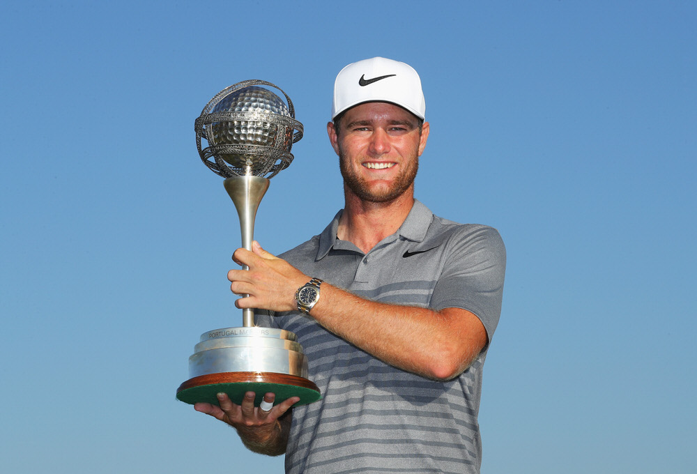 Lucas Bjerregaard of Denmark celebrates victory with the trophy during day four of the Portugal Masters at Dom Pedro Victoria Golf Club on September 24, 2017 in Albufeira, Portugal. (Photo by Warren Little/Getty Images)