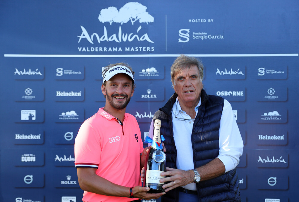 Joost Luiten of the Netherlands receives a bottle of champagne for his albatross on the 11th hole during day two of the Andalucia Valderrama Masters at Real Club Valderrama on October 20, 2017 in Cadiz, Spain.  (Photo by Warren Little/Getty Images)