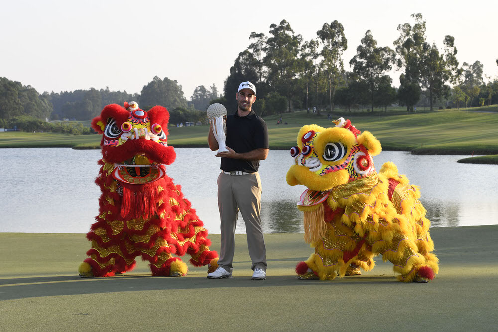 Oliver Farr from Wales with the winner's trophy at Foshan Golf Club, Nanhai, Guangdong Province, China. Credit: Richard Castka/Sportpixgolf.com.