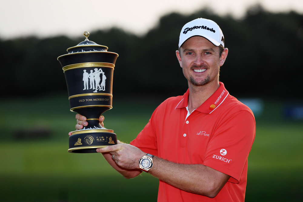 Justin Rose celebrates with the Old Tom Morris Cup after finishing 14 under to win the WGC - HSBC Champions at Sheshan International Golf Club, Shanghai, China.  Photo by Ross Kinnaird/Getty Images