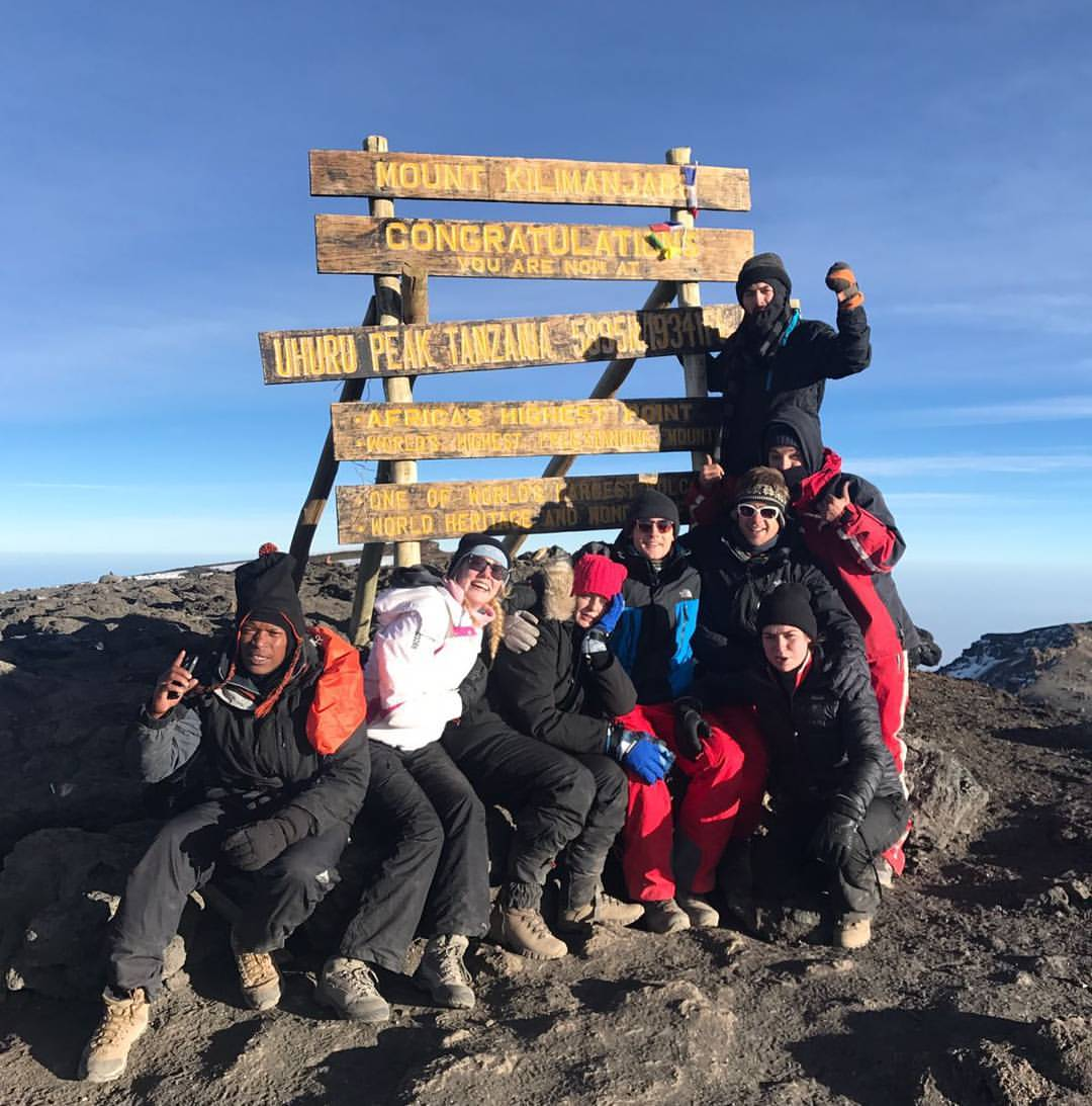 Jack Hume, far right, gives the thumbs up on Mount Kilimanjaro