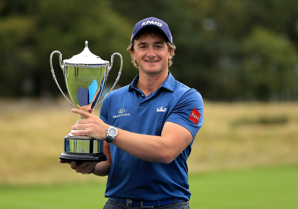 Paul Dunne proudly shows off the trophy after his three-shot win in the British Masters at Close House Golf Club on October 1, 2017. Photo by Andrew Redington/Getty Images