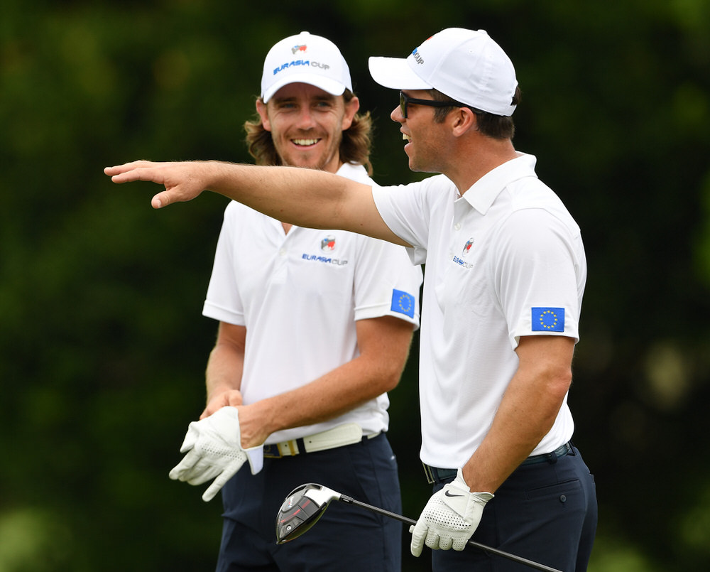 KUALA LUMPUR, MALAYSIA - JANUARY 10:  Paul Casey gestures to Tommy Fleetwood of Team Europe during practice prior to the start of the Eurasia Cup at Glenmarie G&CC on January 10, 2018 in Kuala Lumpur, Malaysia.  (Photo by Stuart Franklin/Getty Images)