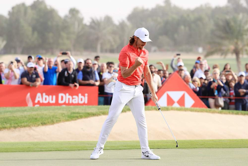Tommy Fleetwood holes out on the 18th to successfully defend the Abu Dhabi HSBC Championship. Picture: Getty Images