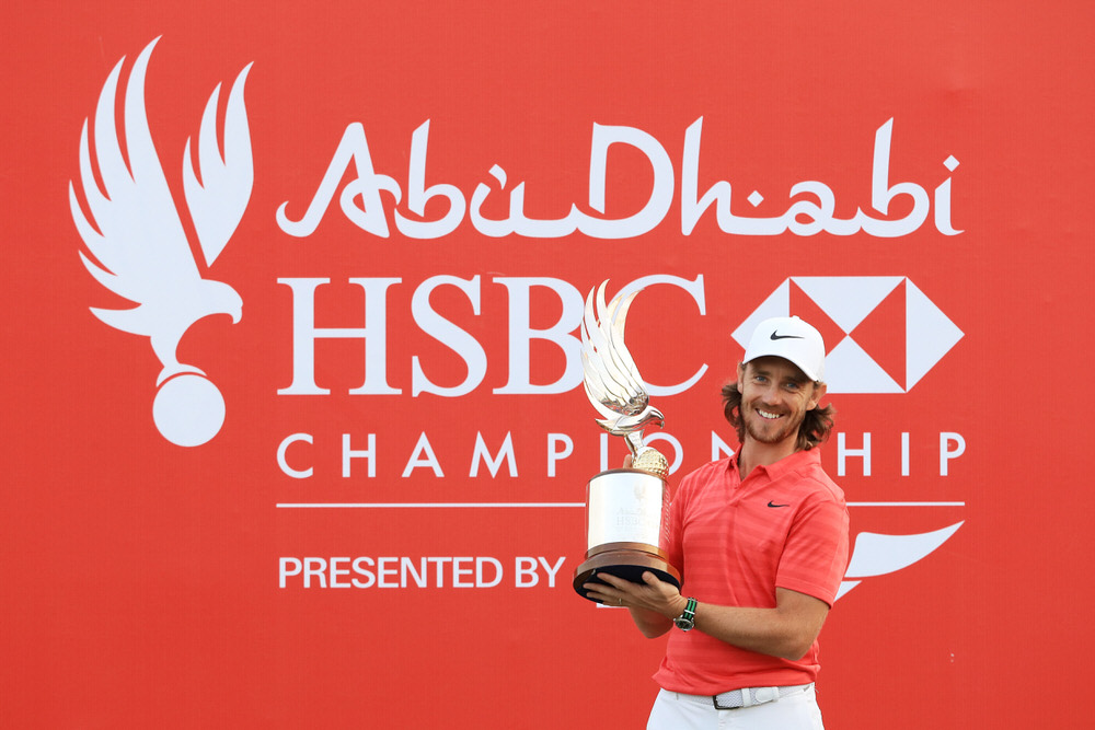 Tommy Fleetwood celebrates with the winner's trophy after the final round of the Abu Dhabi HSBC Golf Championship at Abu Dhabi Golf Club, United Arab Emirates. Photo by Andrew Redington/Getty Images