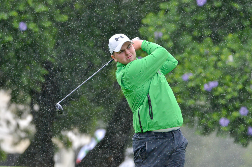 Dundalk's Caolan Rafferty tees off in the rain in round three of the African Amateur Stroke Play. Credit:Ernest Blignault.