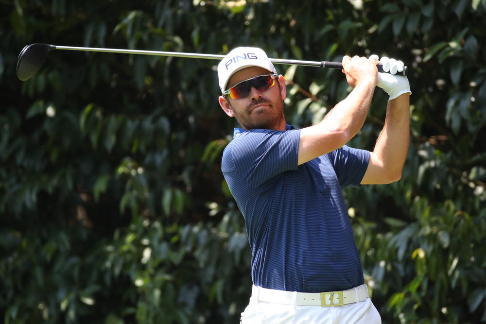 Louis Oosthuizen of South Africa plays his shot from the second tee during the first round of World Golf Championships-Mexico Championship at Club de Golf Chapultepec. Photo by Gregory Shamus/Getty Images
