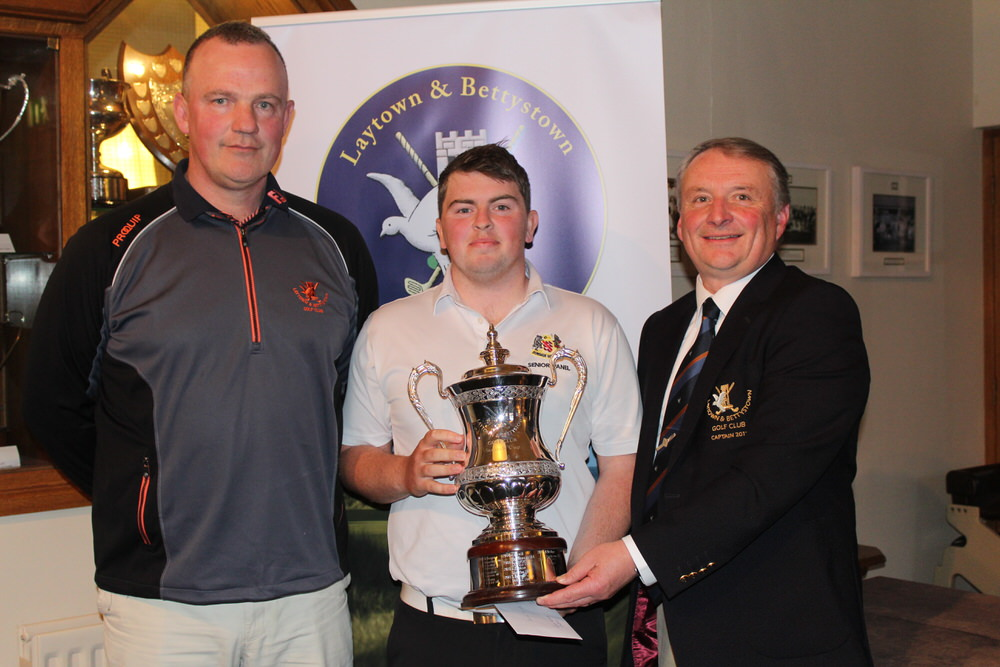 L-R: Scott Kirkpatrick (club professional), winner Caolan Rafferty (Dundalk/Maynooth Univ.), Bryan Collins (Captain, Laytown & Bettystown).Photo courtesy of Joe Ryan