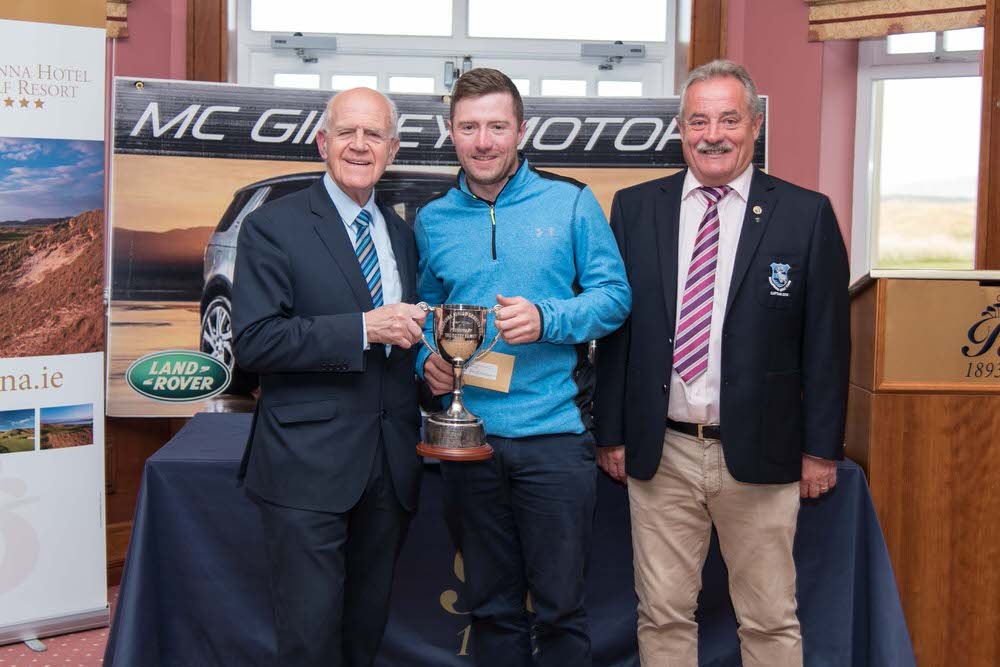 Noel McGinley of McGinley Motors, Letterkenny (left) and Rosapenna Captain Liam Breen (right) present the Rosapenna Junior Scratch Cup to Gweedore's Pol O Maologain. Picture:Martin Fleming
