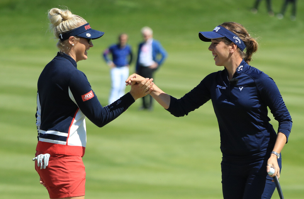 Charley Hull and Georgia Hall of England Women celebrate on the 6th hole during Day One of the GolfSixes at The Centurion Club in St Albans, England. Photo by Andrew Redington/Getty Images