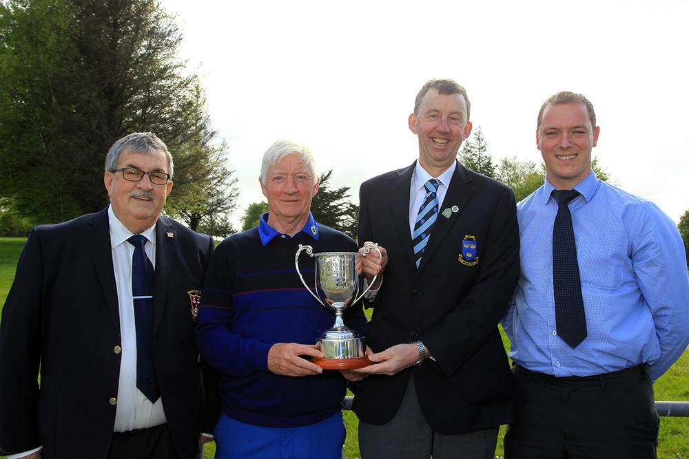 Maurice Kelly (Naas) receiving the Munster Veterans trophy