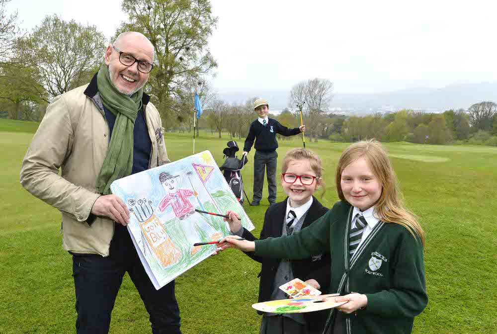 Brian McIlroy of the Rory Foundation and primary school pupils Tiarna (6) and Gracey (9), brush up on their drawing skills with model golfer Sean (7) to launch a nationwide children's competition that will give kids throughout Ireland a chance to win some fabulous prizes for their school and family.