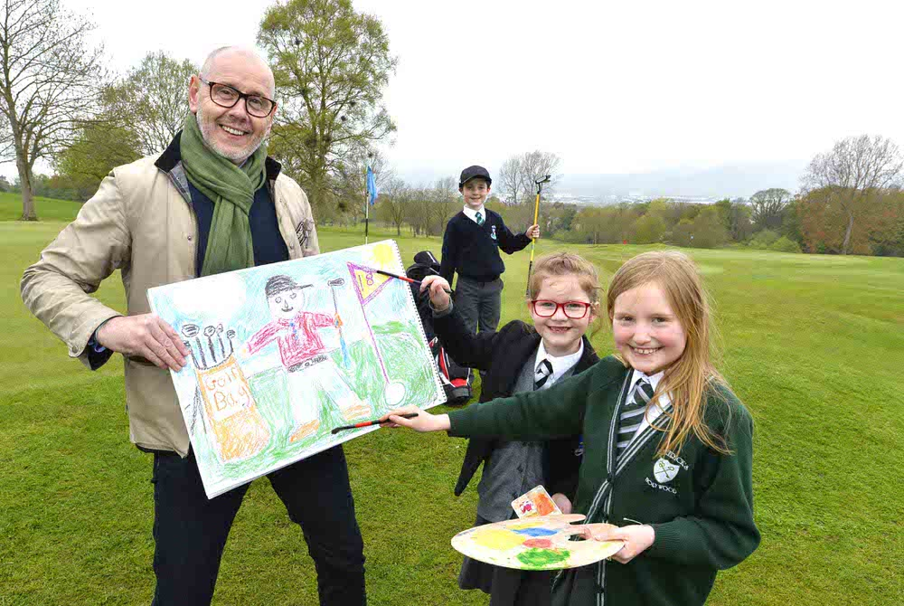 PUTT YOURSELF IN THE PICTURE:  Brian McIlroy of the Rory Foundation and primary school pupils Tiarna (6) and Gracey (9), brush up on their drawing skills with model golfer Sean (7) to launch a nationwide children�s competition that will give kids throughout Ireland a chance to win some fabulous prizes for their school and family.  Organised by the Dubai Duty Free Irish Open, which will take place at Ballyliffin Golf Club in County Donegal from July 5-8, the �Putt Yourself In The Picture� competition gives children a chance to win a unique opportunity for their school to host a visit from the prestigious Waterford Crystal trophy � as well as a family pass and VIP Tour at the tournament�s Pro Am on Wednesday July 4.  The winning picture will also be put on display at the tournament for players and spectators to see, and signed by Dubai Duty Free Irish Open host Rory McIlroy and defending champion Jon Rahm before being auctioned to raise money for the winner�s school.  To enter, schoolchildren of all ages � or their parents and teachers - should simply draw a golf-themed drawing of anything that inspires them and send it to trophytour@duffyrafferty.com along with contact details clearly stating the child�s name, age, address and school.  Alternatively, parents and teachers can tweet photos to @ddfirishopen or post on the Dubai Duty Free Irish Open Facebook page with the hashtags #ddfirishopen and #puttyourselfinthepicture.  Closing date for entries is Sunday June 10 with the school visit taking place during the week of June 18-22.